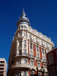 An ornate building stands out against the deep blue sky in Cartagena